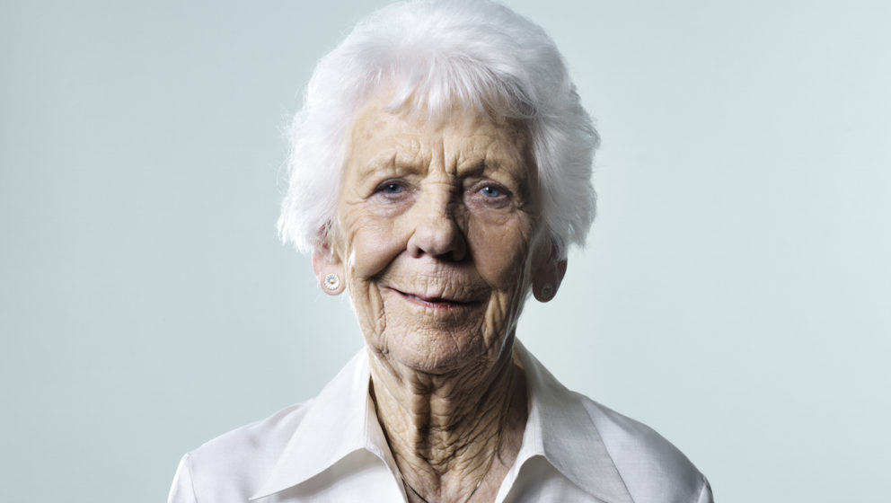 Mature woman being thoughtful and reflecting on the good life she has lived.