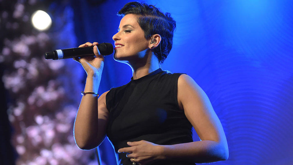 BEVERLY HILLS, CALIFORNIA - APRIL 06:  Recording artist Nelly Furtado performs onstage during the WE Day Celebration Dinner a