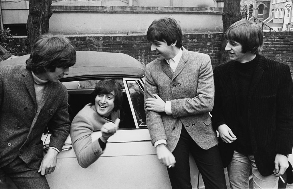 UNITED KINGDOM - FEBRUARY 16:  The Beatles, John Lennon In A Car After His Driving Test On February 16Th 1965  (Photo by Keys