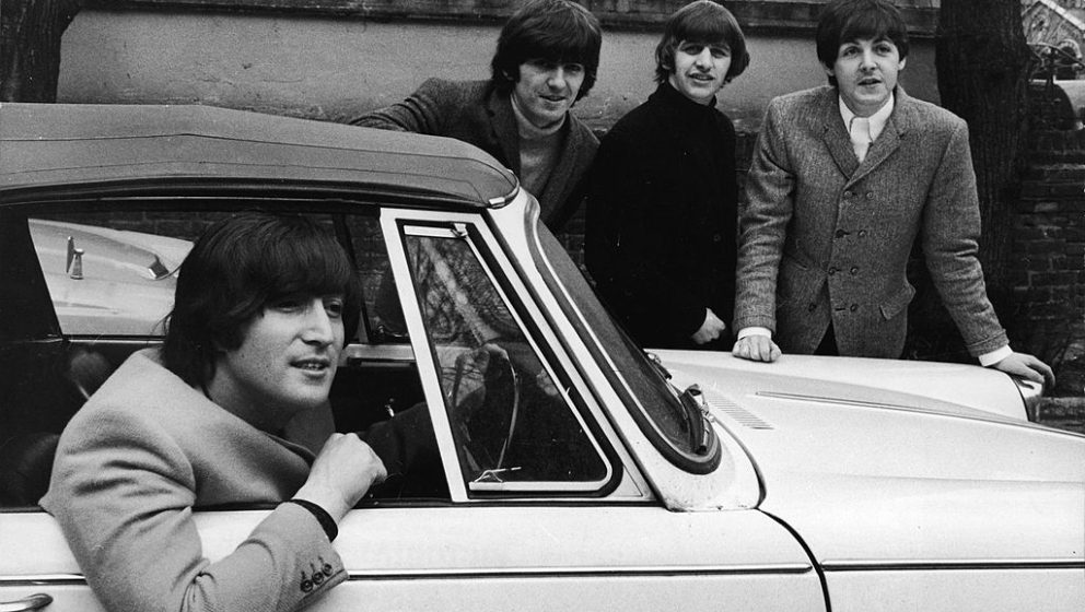 John Lennon (1940 - 1980), of the British pop group the Beatles, sits in his car after passing his driving test, February 16,