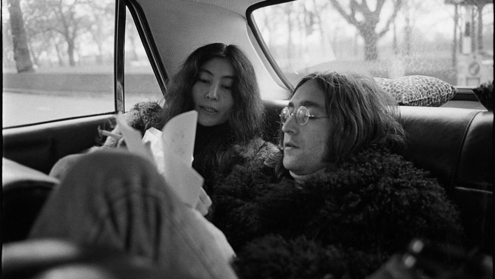 Japanese-born artist and musician Yoko Ono and British musican and artist John Lennon (1940 - 1980) ride together in the back