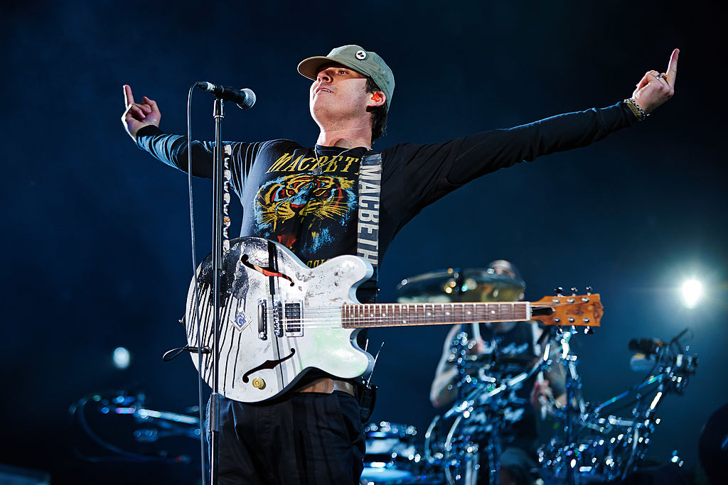 LEEDS, UNITED KINGDOM - AUGUST 22: Tom DeLonge of Blink 182 performs on stage at Leeds Festival at Bramham Park on August 22,