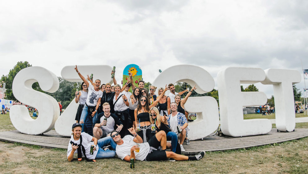 BUDAPEST, HUNGARY - AUGUST 11:  Festival goers pose next to the Sziget sign at the Sziget Festival 2016 on August 11, 2016 in