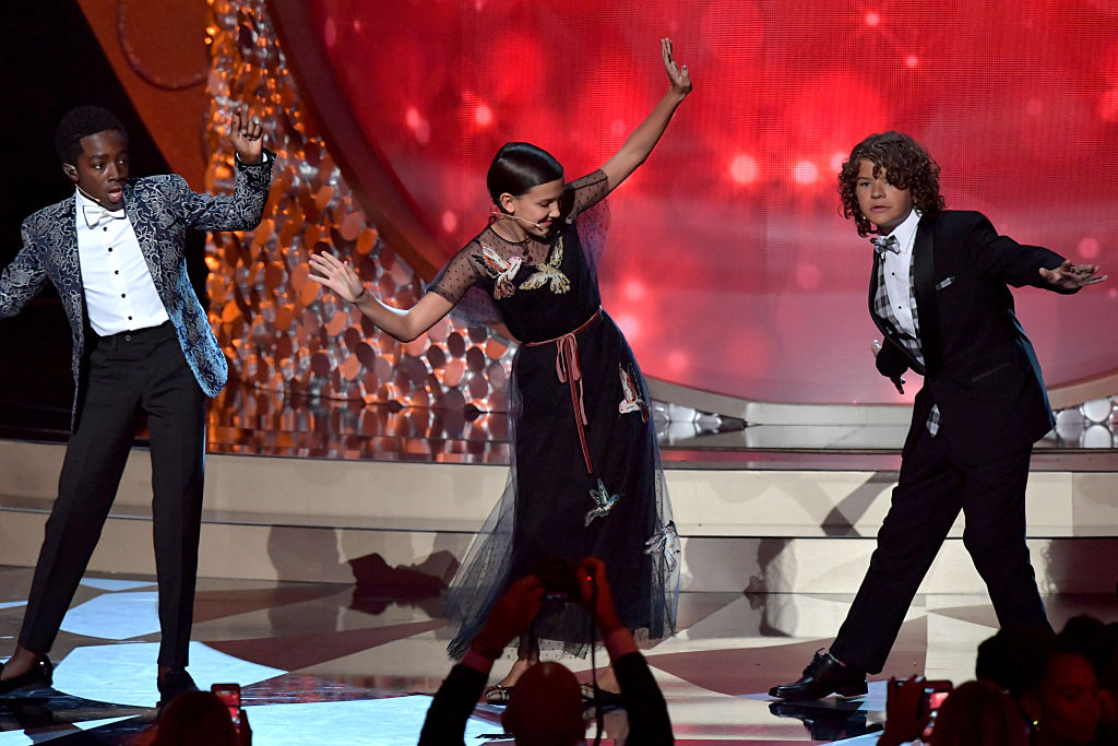 LOS ANGELES, CA - SEPTEMBER 18:  (L-R) Actors Caleb McLaughlin, Millie Bobby Brown and Gaten Matarazzo perform onstage during