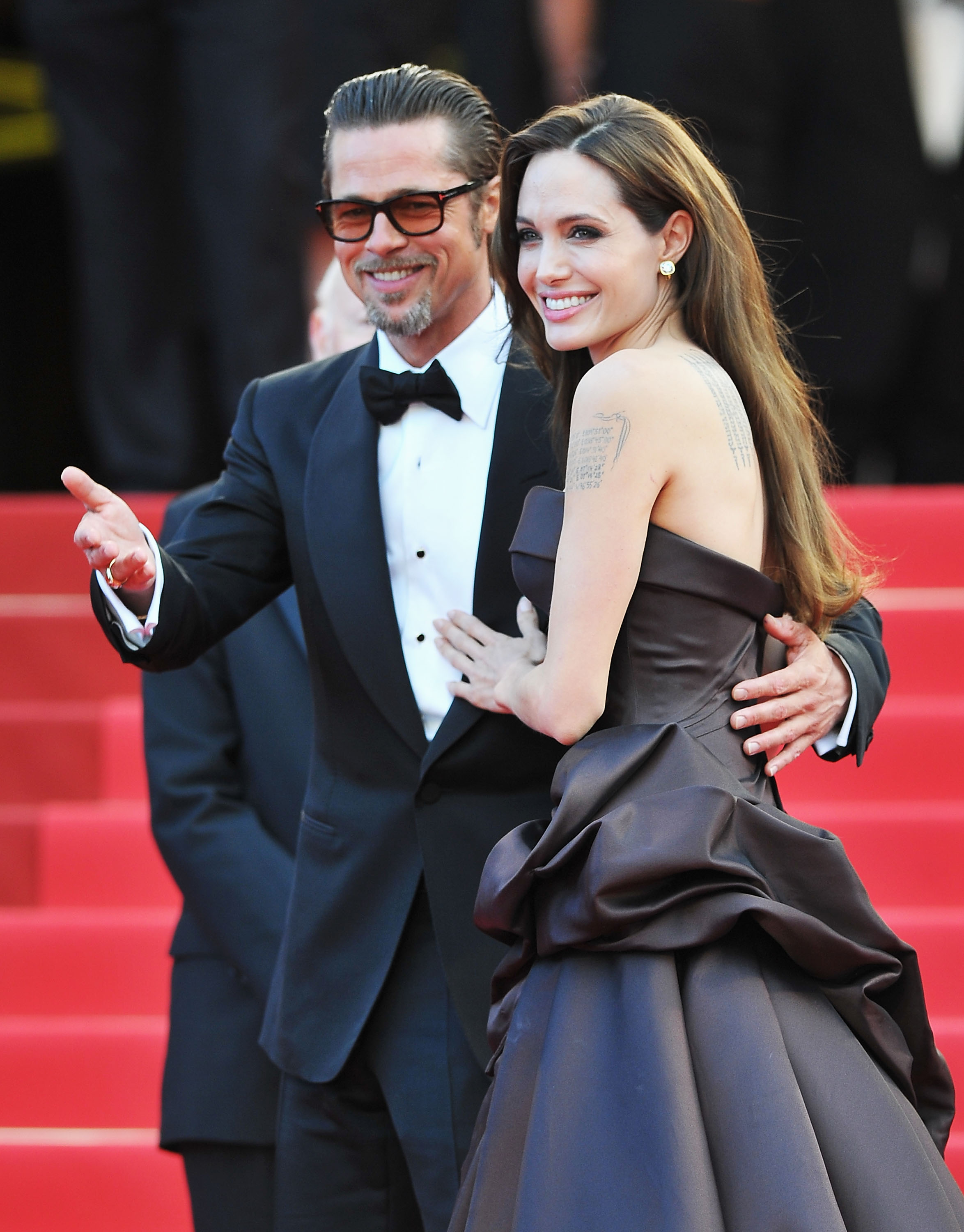 """CANNES, FRANCE - MAY 16: Angelina Jolie (R) and Brad Pitt attend """"The Tree Of Life"""" premiere during the 64th Annual Cannes Film Festival at Palais des Festivals on May 16, 2011 in Cannes, France. (Photo by Pascal Le Segretain/Getty Images)"""