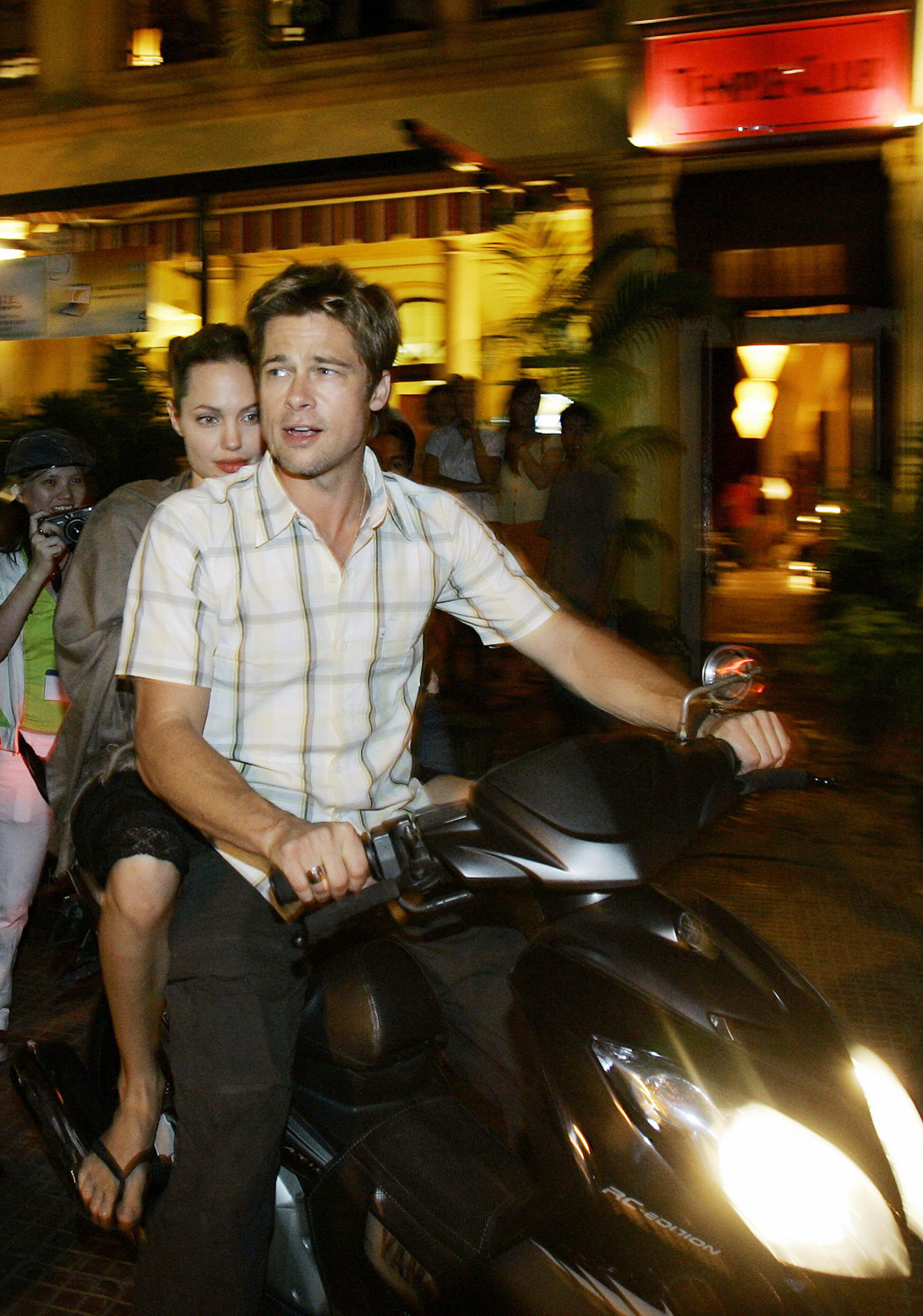 Ho Chi Minh City, VIET NAM:  Hollywood stars Brad Pitt and his partner Angelina Jolie leave the Temple Club restaurant where