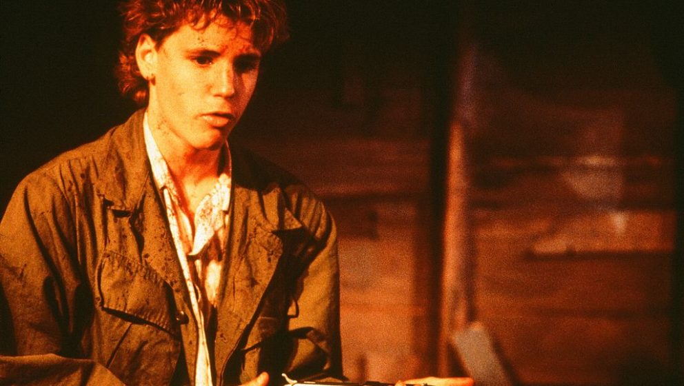 CIRCA 1988: Corey Haim holds a rifle as he is covered in blood in a scene from the Universal Studio movie  'Watchers' circa 1
