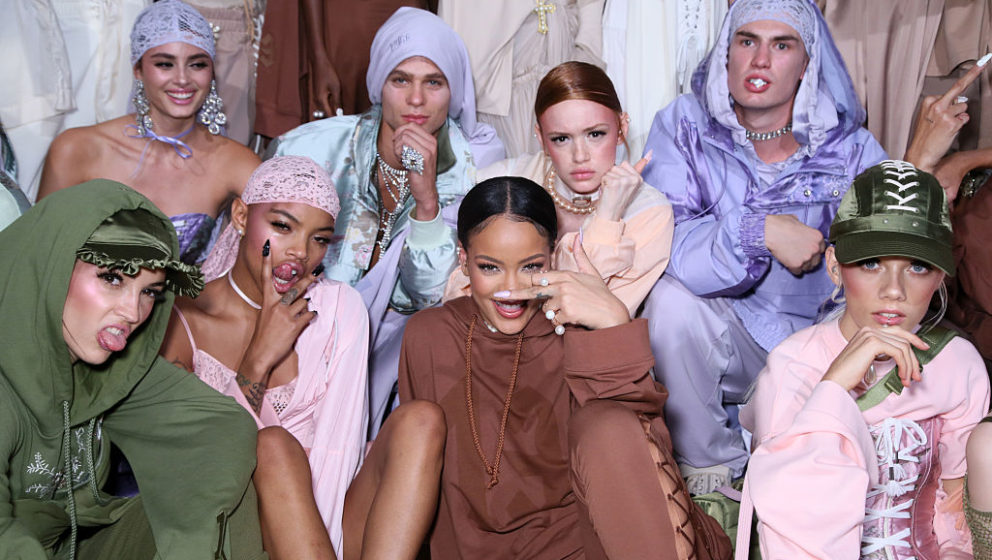 PARIS, FRANCE - SEPTEMBER 28:  Rihanna is seen with models backstage during FENTY x PUMA by Rihanna at Hotel Salomon de Roths