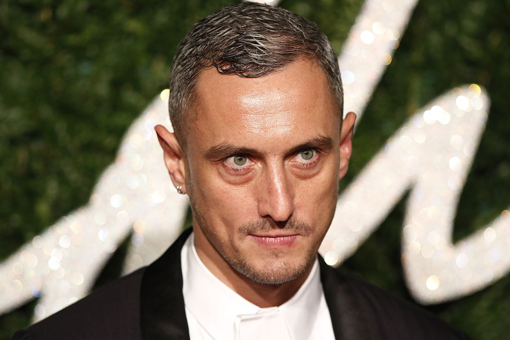 British fashion designer Richard Nicoll poses for pictures on the red carpet upon arrival to attend the British Fashion Awards 2014 in London on December 1, 2014. AFP PHOTO/JUSTIN TALLIS (Photo credit should read JUSTIN TALLIS/AFP/Getty Images)