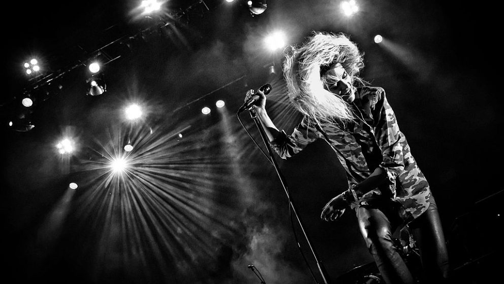 BERLIN, GERMANY - OCTOBER 22: (EDITORS NOTE: Image has been converted to black and white.) Singer Alison Mosshart of the British-American band The Kills performs live during a concert at the Tempodrom on October 22, 2016 in Berlin, Germany. (Photo by Frank Hoensch/Redferns)