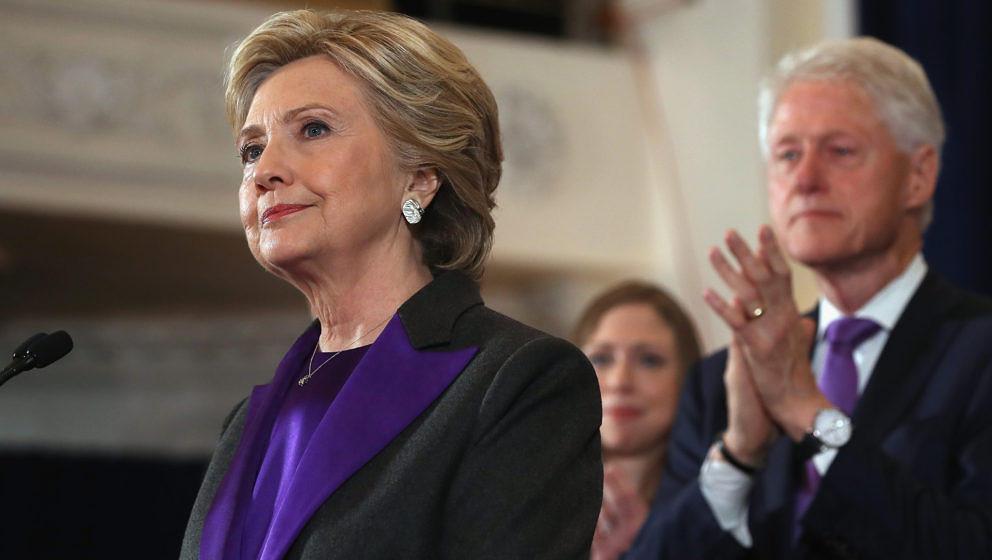 NEW YORK, NY - NOVEMBER 09:  Former Secretary of State Hillary Clinton, accompanied by her husband former President Bill Clin