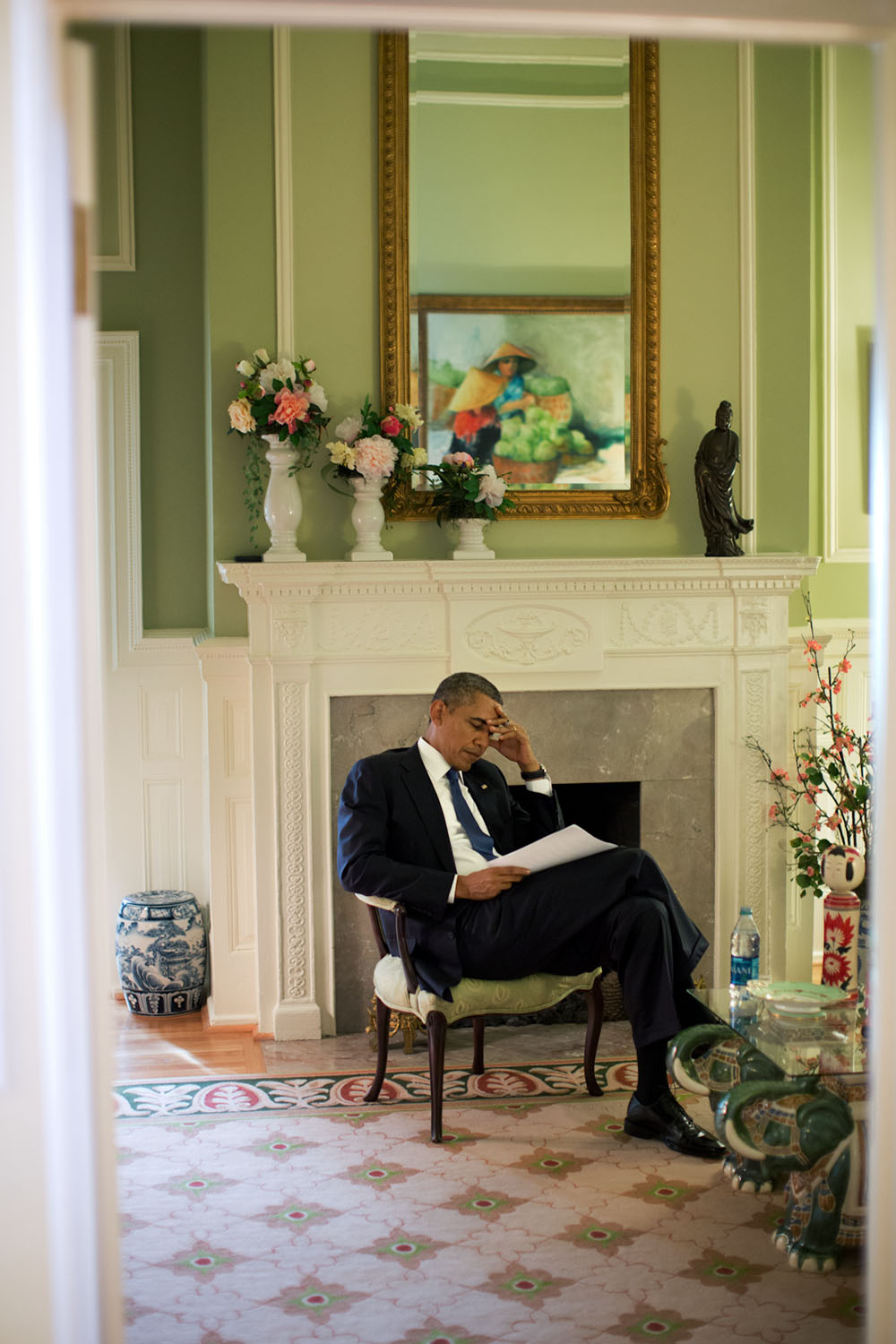 """Sept. 22, 2013 """"The President edits his speech before delivering remarks at a memorial service for victims of the Washington Navy Yard shootings. It is not uncommon for the President to be making final edits to a speech only moments before being introduced. Such was the case here."""" (Official White House Photo by Pete Souza) This official White House photograph is being made available only for publication by news organizations and/or for personal use printing by the subject(s) of the photograph. The photograph may not be manipulated in any way and may not be used in commercial or political materials, advertisements, emails, products, promotions that in any way suggests approval or endorsement of the President, the First Family, or the White House."""