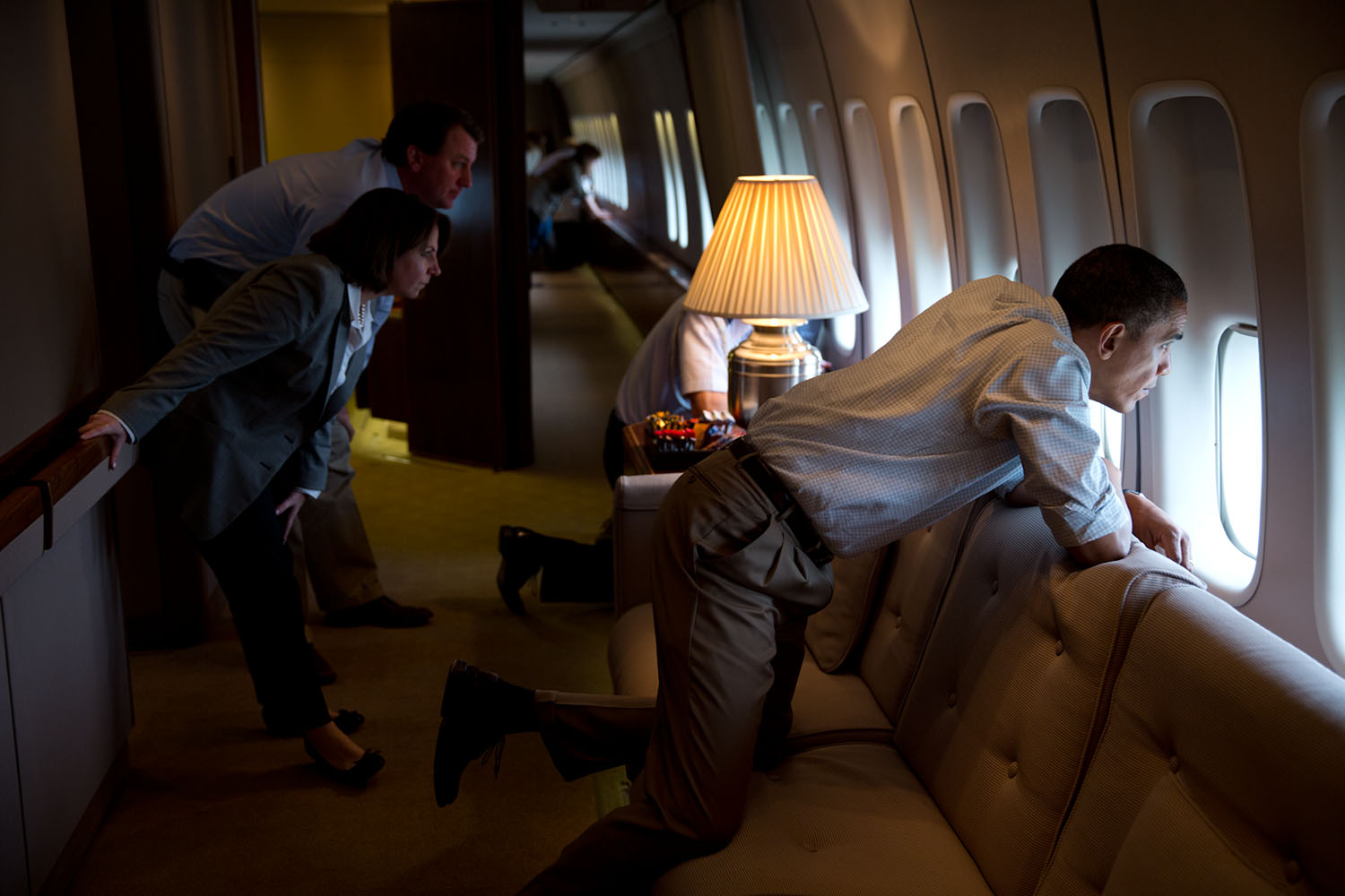 """May 26, 2013 """"The President and members of the White House staff look out the window of Air Force One to view tornado damage over Moore, Oklahoma. After landing at Tinker Air Base, the President did a walking tour of the damage and met with those affected."""" (Official White House Photo by Pete Souza) This official White House photograph is being made available only for publication by news organizations and/or for personal use printing by the subject(s) of the photograph. The photograph may not be manipulated in any way and may not be used in commercial or political materials, advertisements, emails, products, promotions that in any way suggests approval or endorsement of the President, the First Family, or the White House."""