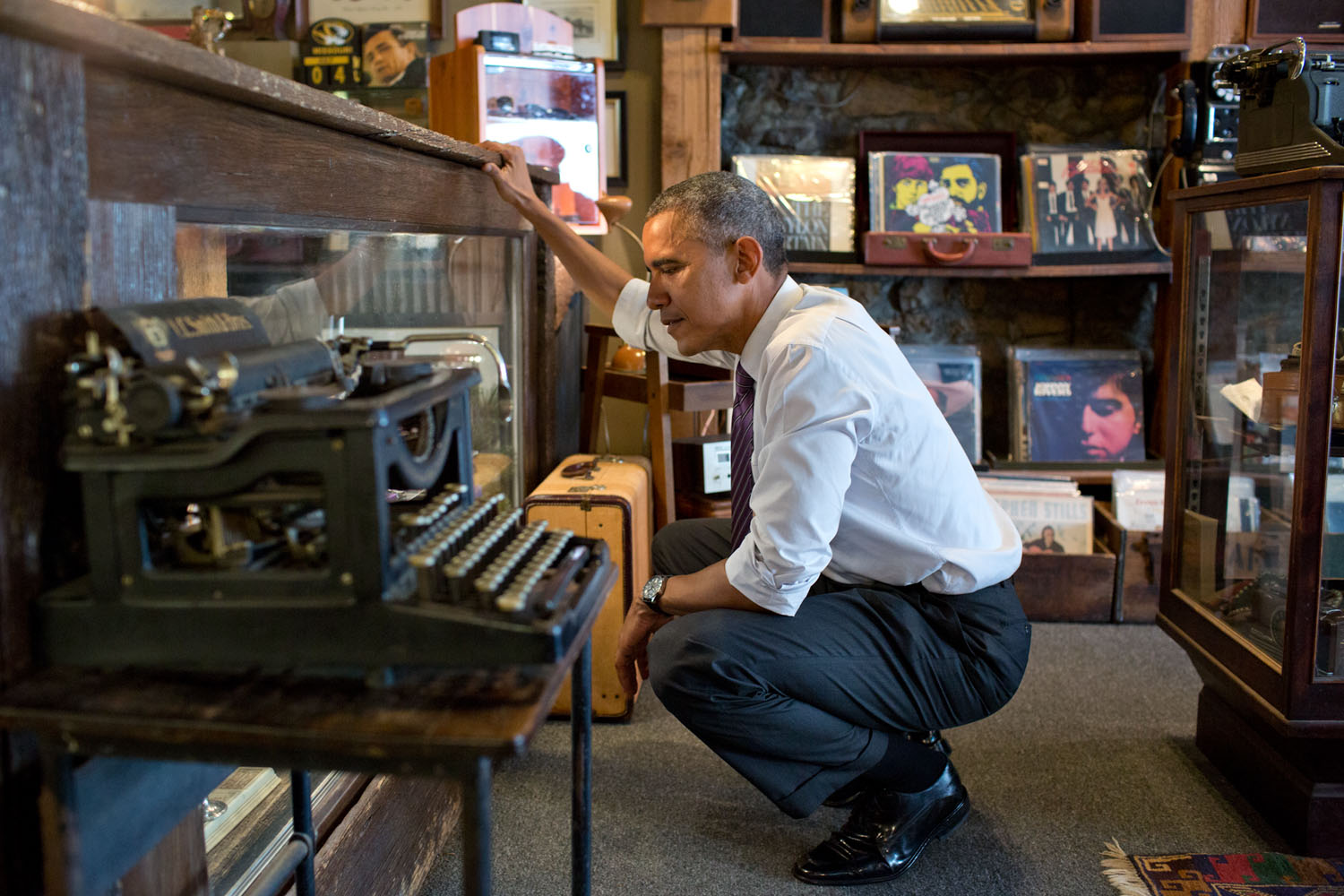 """July 30, 2014 """"I'm including this photograph because the President just loved looking around at Cool Vintage Watches in Parkville, Missouri. 'A lot of cool stuff,' was how he described it to me afterwards. He said he could have spent a lot more time looking around in the shop, which had much more than just watches."""" (Official White House Photo by Pete Souza) This official White House photograph is being made available only for publication by news organizations and/or for personal use printing by the subject(s) of the photograph. The photograph may not be manipulated in any way and may not be used in commercial or political materials, advertisements, emails, products, promotions that in any way suggests approval or endorsement of the President, the First Family, or the White House."""