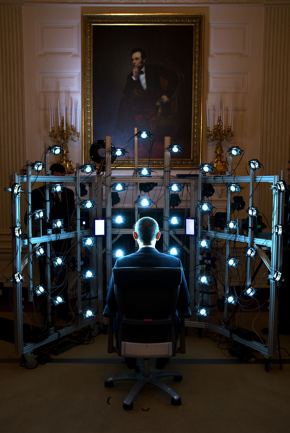 """June 9, 2014 """"The President sits for a 3D portrait being produced by the Smithsonian Institution. There were so many cameras and strobe lights flashing but the end result was kind of cool. See the video at this link: http://1.usa.gov/1zhPtAf."""" (Official White House Photo by Pete Souza) This official White House photograph is being made available only for publication by news organizations and/or for personal use printing by the subject(s) of the photograph. The photograph may not be manipulated in any way and may not be used in commercial or political materials, advertisements, emails, products, promotions that in any way suggests approval or endorsement of the President, the First Family, or the White House."""
