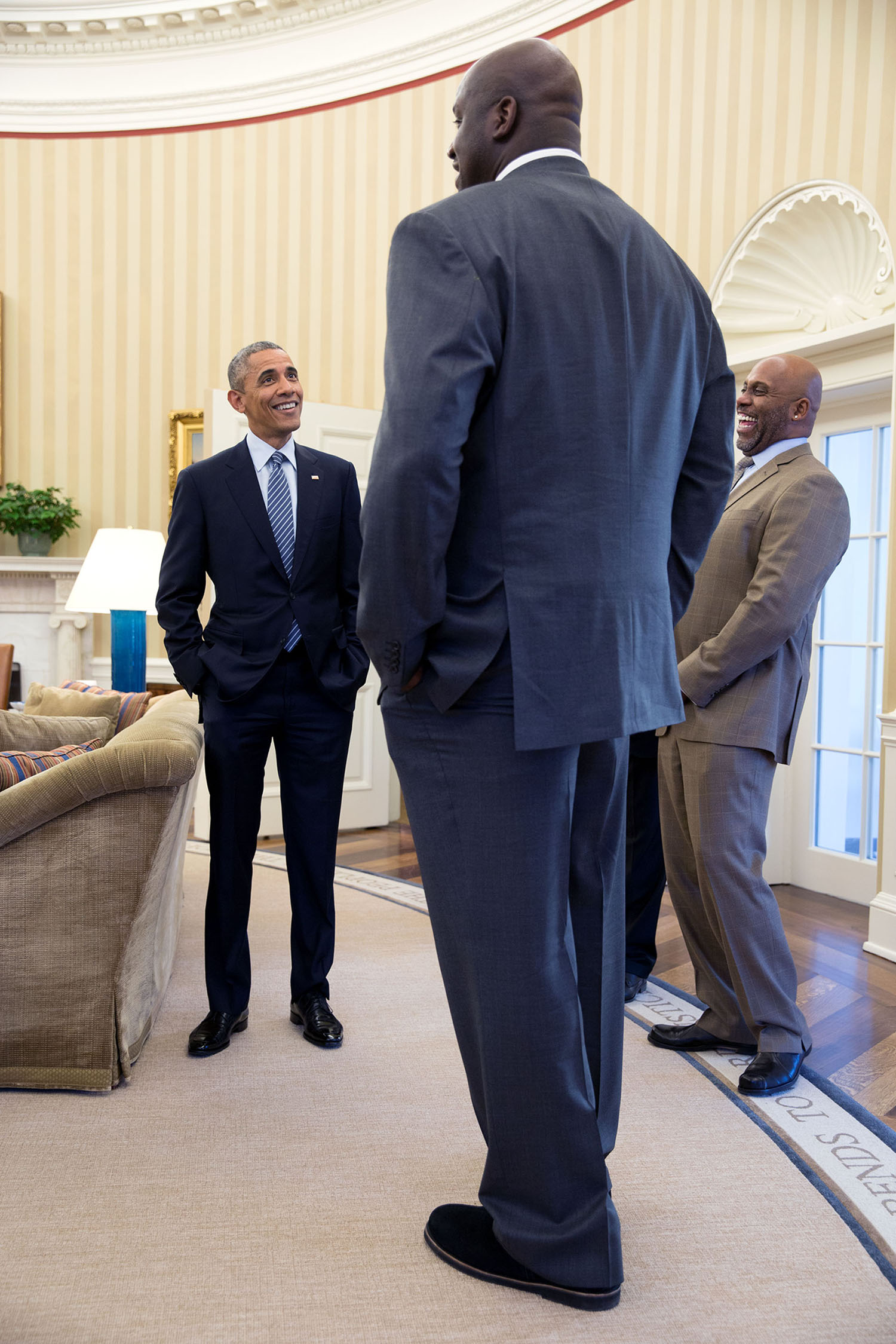 """Feb. 27, 2015 """"It's definitely true that former NBA player Shaquille O'Neal is a big guy. But I'll admit that I used a wide angle lens and this angle to accentuate his size when he stopped by the Oval Office for a quick visit."""" (Official White House Photo by Pete Souza) This official White House photograph is being made available only for publication by news organizations and/or for personal use printing by the subject(s) of the photograph. The photograph may not be manipulated in any way and may not be used in commercial or political materials, advertisements, emails, products, promotions that in any way suggests approval or endorsement of the President, the First Family, or the White House."""