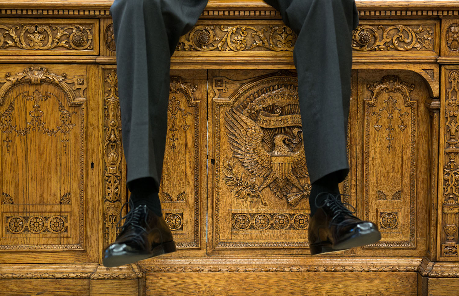 """Oct. 1, 2015 """"I focused on the detail of the Resolute Desk as the President was talking with two aides in the Oval Office."""" (Official White House Photo by Pete Souza) This official White House photograph is being made available only for publication by news organizations and/or for personal use printing by the subject(s) of the photograph. The photograph may not be manipulated in any way and may not be used in commercial or political materials, advertisements, emails, products, promotions that in any way suggests approval or endorsement of the President, the First Family, or the White House."""