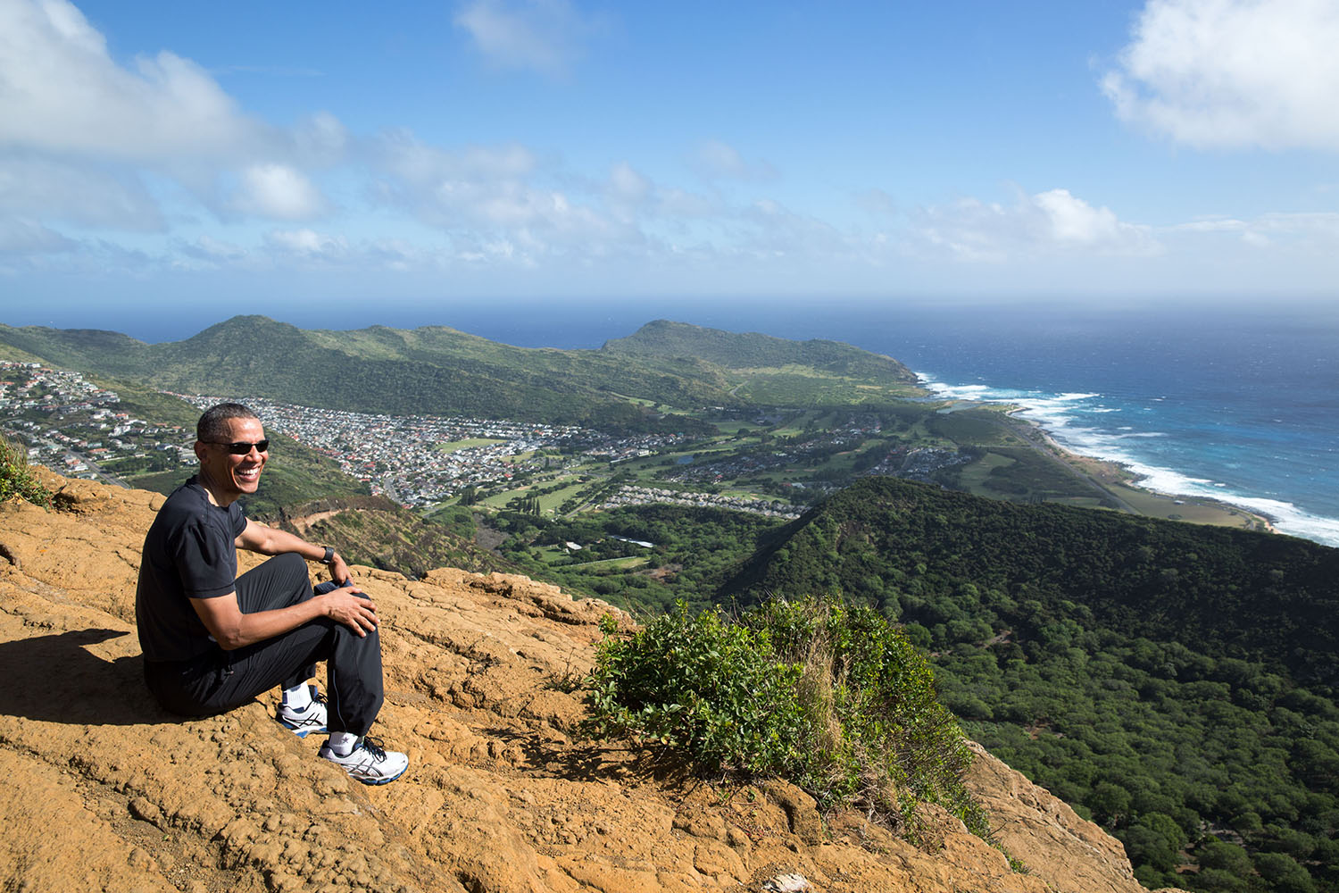 """Dec. 22, 2015 """"When some of my friends heard that the President had hiked the grueling Koko Head Crater Trail, they sent me messages on whether I had made it to the top. The trail is 1,048 wooden steps, which climb more than 1,200 feet up the crater's ridge. Some call it the 'Stairmaster from Hell.' I'll admit that I was huffing and puffing up the trail, but to my friends, this photograph is proof that I indeed made it to the top with my boss."""" (Official White House Photo by Pete Souza) This official White House photograph is being made available only for publication by news organizations and/or for personal use printing by the subject(s) of the photograph. The photograph may not be manipulated in any way and may not be used in commercial or political materials, advertisements, emails, products, promotions that in any way suggests approval or endorsement of the President, the First Family, or the White House."""