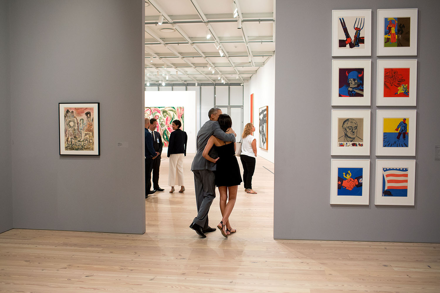"""July 17, 2015 """"While visiting the Whitney Museum in New York City, the President hugged his daughter Malia as they looked at the art work."""" (Official White House Photo by Pete Souza) This official White House photograph is being made available only for publication by news organizations and/or for personal use printing by the subject(s) of the photograph. The photograph may not be manipulated in any way and may not be used in commercial or political materials, advertisements, emails, products, promotions that in any way suggests approval or endorsement of the President, the First Family, or the White House."""
