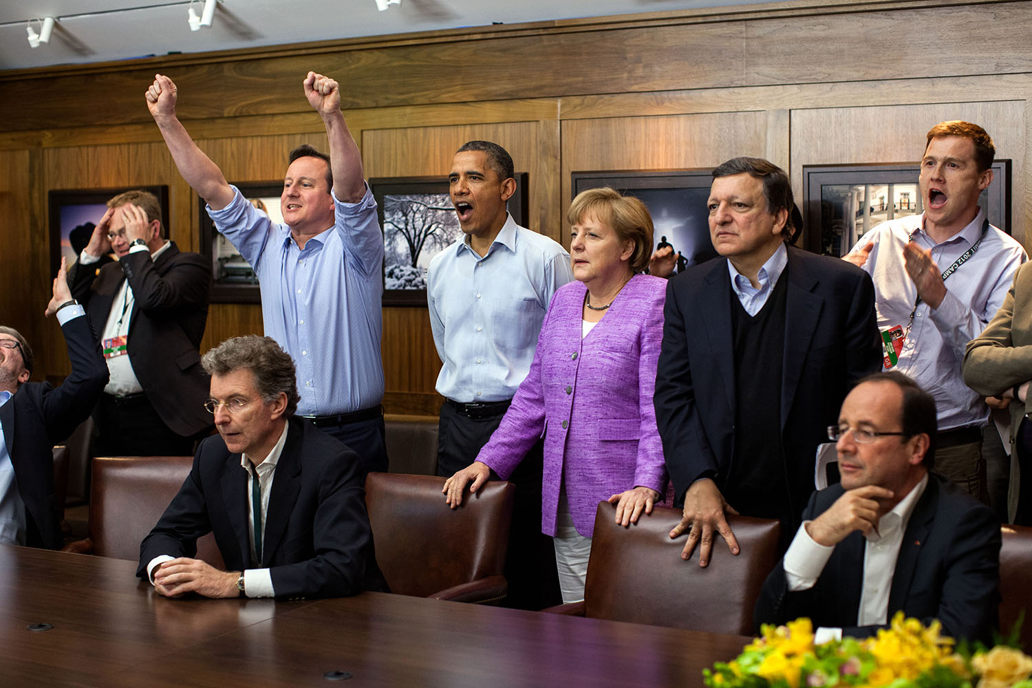 """May 19, 2012 """"At Camp David for the G8 Summit, European leaders took a break to watch the overtime shootout of the Chelsea vs. Bayern Munich Champions League final. Prime Minister David Cameron of the United Kingdom, the President, Chancellor Angela Merkel of Germany, José Manuel Barroso, President of the European Commission, French President Francois Hollande react during the winning goal."""" (Official White House Photo by Pete Souza) This official White House photograph is being made available only for publication by news organizations and/or for personal use printing by the subject(s) of the photograph. The photograph may not be manipulated in any way and may not be used in commercial or political materials, advertisements, emails, products, promotions that in any way suggests approval or endorsement of the President, the First Family, or the White House."""