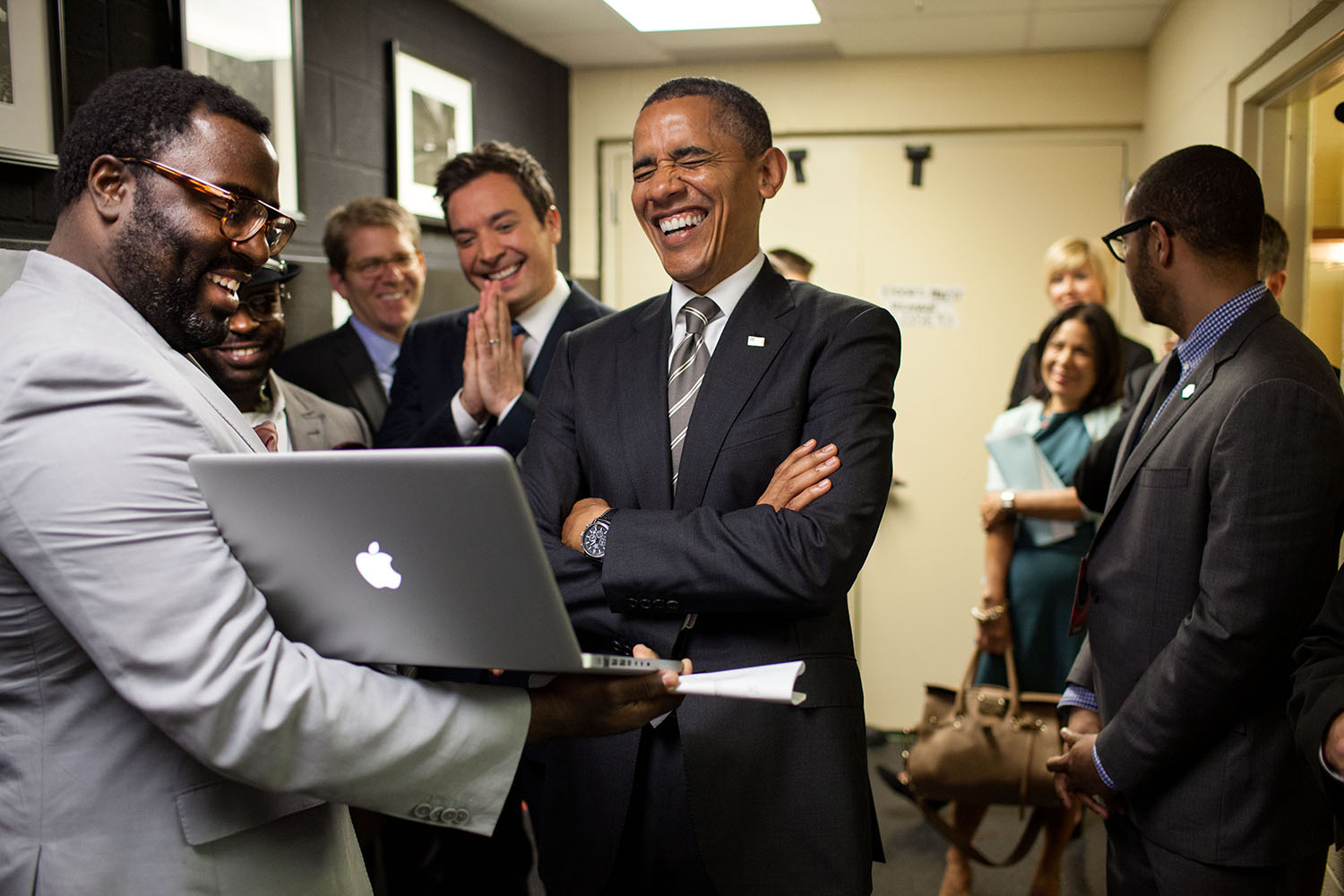 """April 24, 2012 """"We were backstage at the University of North Carolina in Chapel Hill for the President's appearance on 'Late Night with Jimmy Fallon.' The President let out a big laugh as he was being briefed by the producers and Mr. Fallon on the 'Slow Jam the News' segment."""" (Official White House Photo by Pete Souza) This official White House photograph is being made available only for publication by news organizations and/or for personal use printing by the subject(s) of the photograph. The photograph may not be manipulated in any way and may not be used in commercial or political materials, advertisements, emails, products, promotions that in any way suggests approval or endorsement of the President, the First Family, or the White House."""