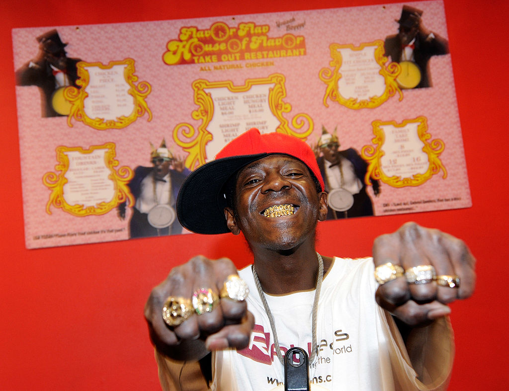 LAS VEGAS, NV - MARCH 14: Rapper Flavor Flav poses in front of a menu on the wall of his Flavor Flav House of Flavor Take Out Restaurant on March 14, 2012 in Las Vegas, Nevada. Flav is holding the official grand opening for his new eatery on March 15. (Photo by Ethan Miller/Getty Images)