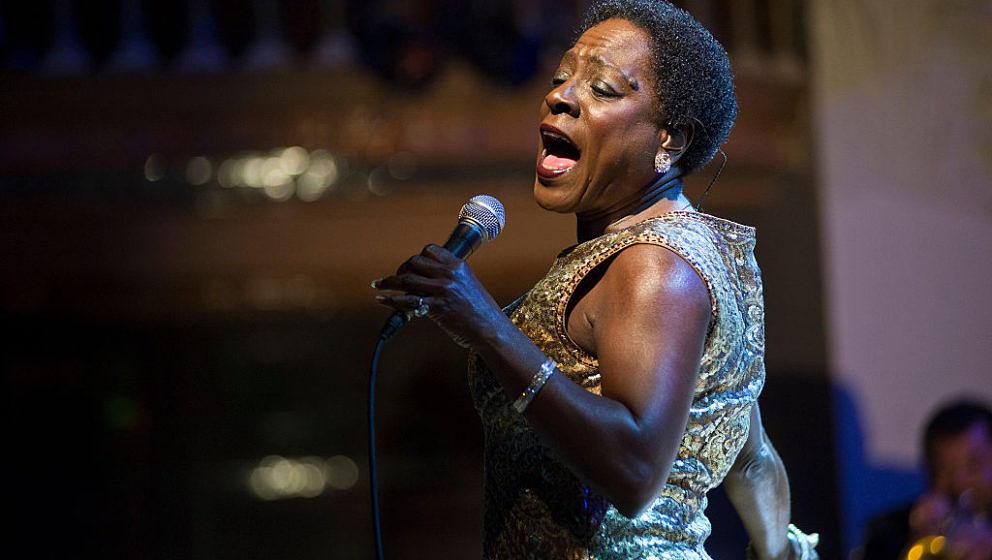 BARCELONA, SPAIN - NOVEMBER 18: Sharon Jones performs on stage at Palau De La Musica on November 18, 2014 in Barcelona, Spain. (Photo by Jordi Vidal/Redferns via Getty Images)