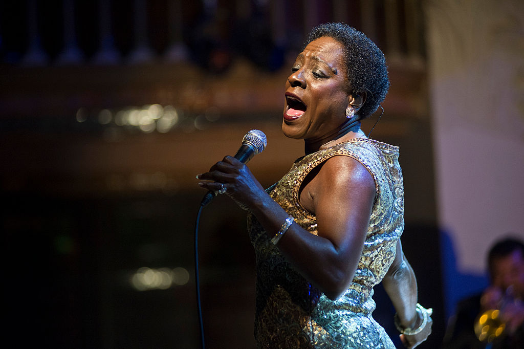BARCELONA, SPAIN - NOVEMBER 18: Sharon Jones performs on stage at Palau De La Musica on November 18, 2014 in Barcelona, Spain. (Photo by Jordi Vidal/Redferns via Getty Images)