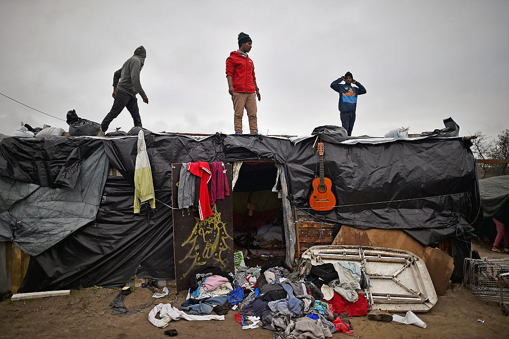 CALAIS, FRANCE - DECEMBER 01: Migrants contend with wintery conditions in the camp known as the 'New Jungle' on December 1, 2015 in Calais, France. Thousands of migrants continue to live in the makeshift camp in the port town in northern France, where they continue to try and board vehicles heading for ferries or through the tunnel in an attempt to reach Britain. (Photo by Jeff J Mitchell/Getty Images)