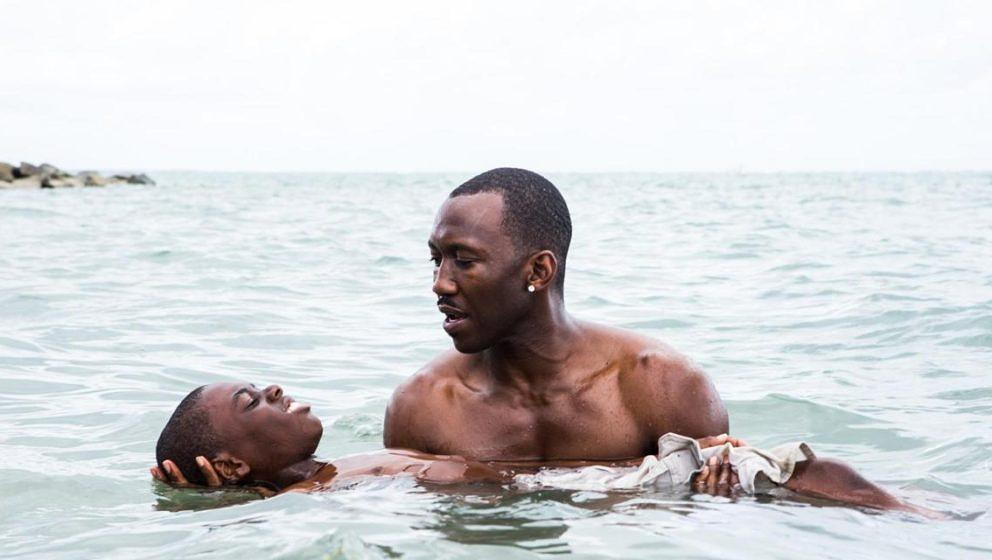 This image released by A24 Films shows Alex Hibbert, left, and Mahershala Ali in a scene from the film, 'Moonlight.'  The fil