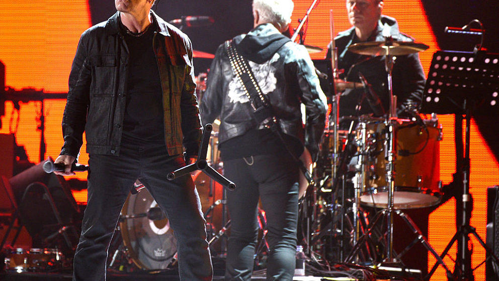 SAN FRANCISCO, CA - OCTOBER 05:  Bono, Adam Clayton and Larry Mullen Jr.  of U2 perform during the 2016 UCSF Benioff Children