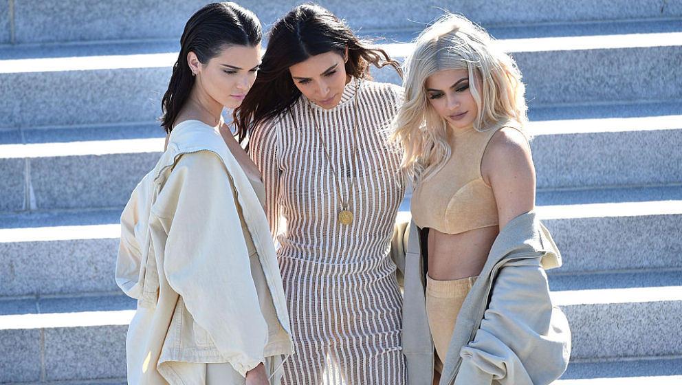 NEW YORK, NY - SEPTEMBER 07:  (L-R) Kendall Jenner, Kim Kardashian and Kylie Jenner attend the Kanye West Yeezy Season 4 fash