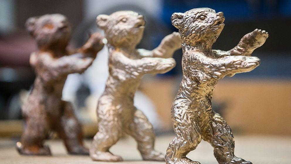 Bronze bears in different stages of the process are seen with a finished one (R) during production of  Bear trophies for the