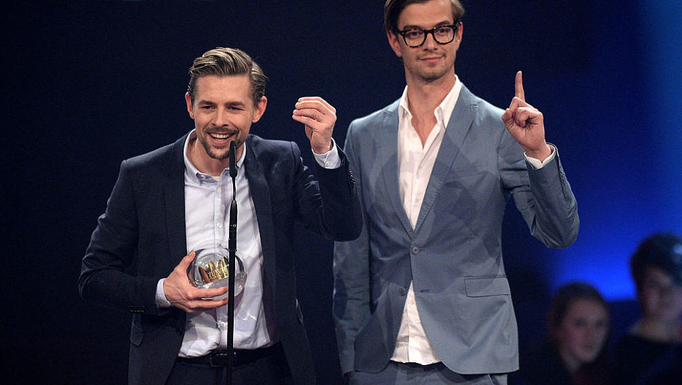 BOCHUM, GERMANY - DECEMBER 04: (L-R) Klaas Heufer-Umlauf and Joko Winterscheidt celebrate winning the 1Live Krone award during the 1Live Krone 2014 at Jahrhunderthalle on December 4, 2014 in Bochum, Germany. (Photo by Sascha Steinbach/Getty Images)