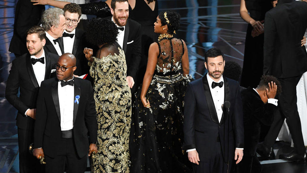 HOLLYWOOD, CA - FEBRUARY 26:  Host Jimmy Kimmel (R) speaks onstage as cast/crew of 'Moonlight' celebrate winning Best Picture