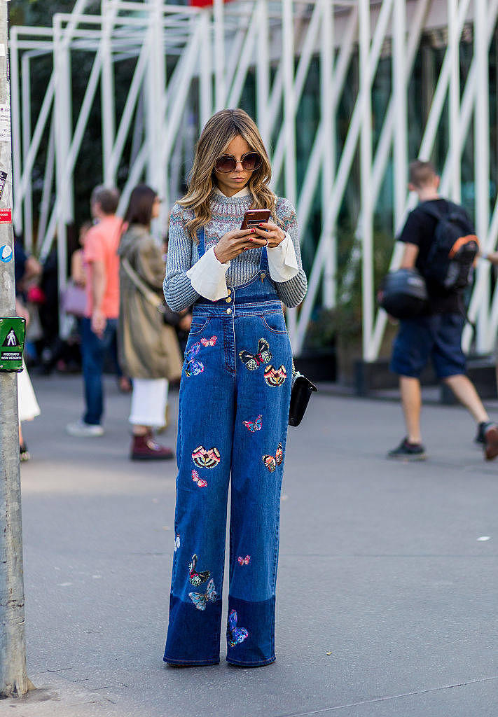 MILAN, ITALY - SEPTEMBER 24: Erica Pelosini wearing a denim overall with patches outside Jil Sander during Milan Fashion Week Spring/Summer 2017 on September 24, 2016 in Milan, Italy. (Photo by Christian Vierig/Getty Images) *** Local Caption *** Erica Pelosini