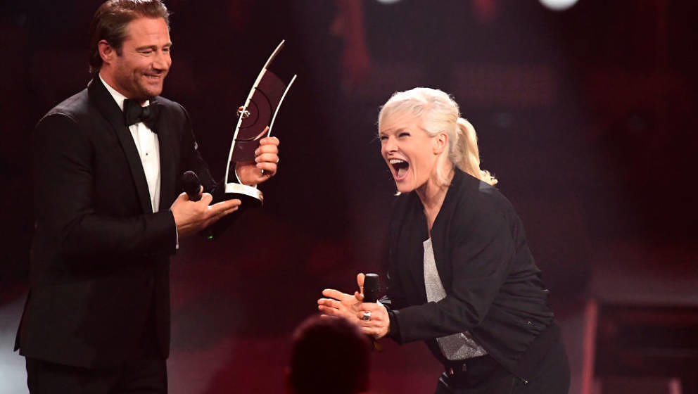 German singer Sasha (L) awards German singer Ina Mueller with the pop national female artist award during the 2017 Echo Music