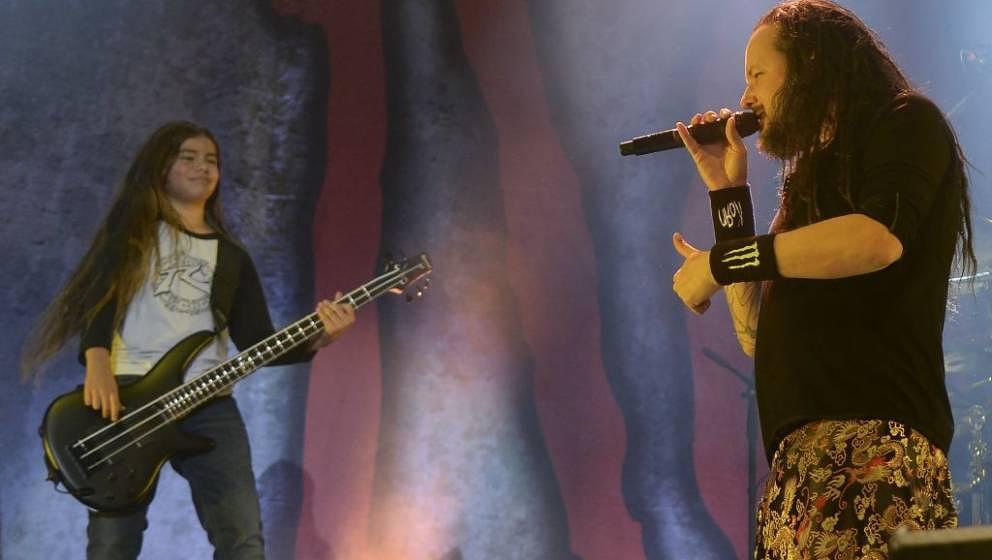 Korn's band Jonathan Davis (R) and  12-year-old Tye Trujillo, son of Metallica's bassist Robert Trujillo perform in Bogota on