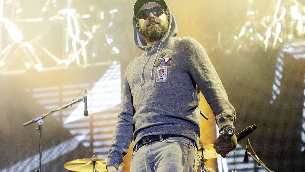 BERLIN, GERMANY - AUGUST 30: German rapper Sido performs live during the concert Stars For Free at the Kindlbuehne Wuhlheide