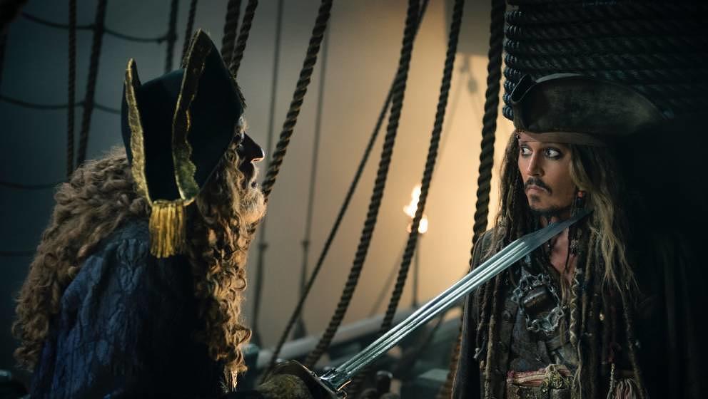 Geoffrey Rush (l.) und Johnny Depp
