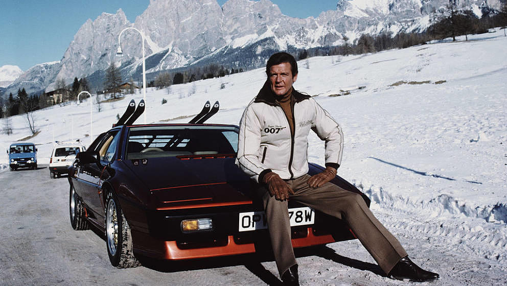 English actor Roger Moore poses as 007, with a Lotus Esprit Turbo, on the set of the James Bond film 'For Your Eyes Only', Fe