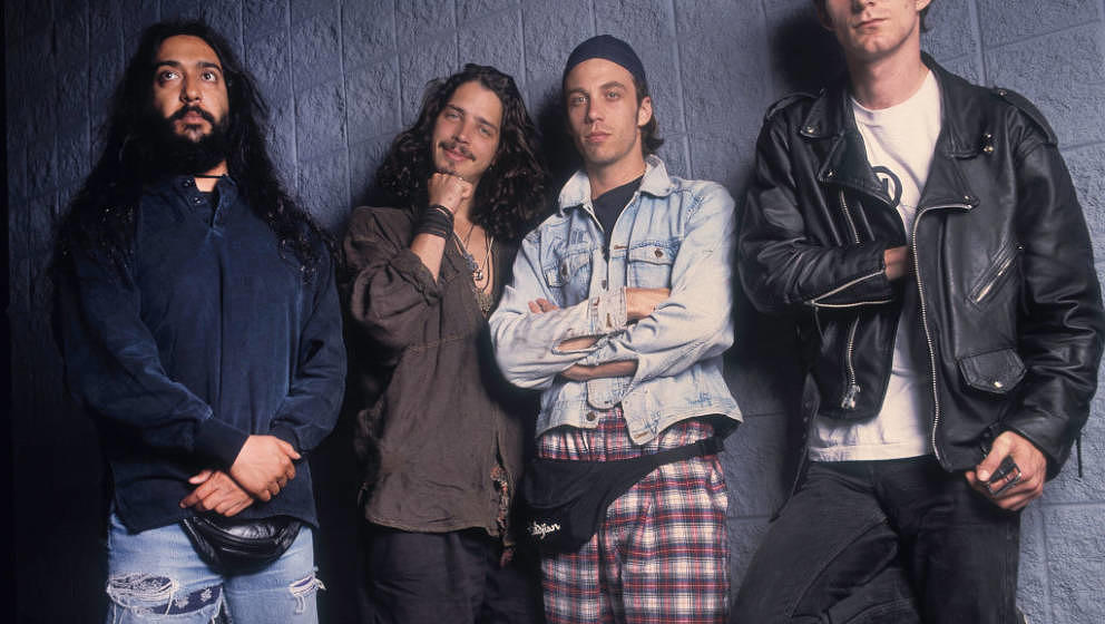 Group portrait of members of the Rock band Soundgarden as they pose at the World Music Theater, Tinley Park, Illinois, August