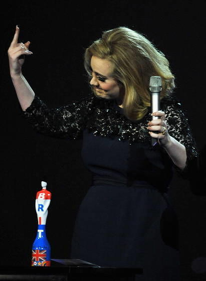 LONDON, ENGLAND - FEBRUARY 21:  Adele swears during The BRIT Awards 2012 at the O2 Arena on February 21, 2012 in London, Engl