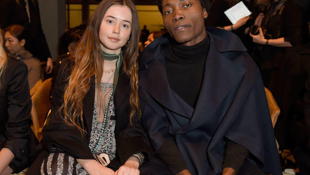 LONDON, ENGLAND - FEBRUARY 20:  Flo Morrissey and Benjamin Clementine wearing Burberry attends the Burberry February 2017 Sho