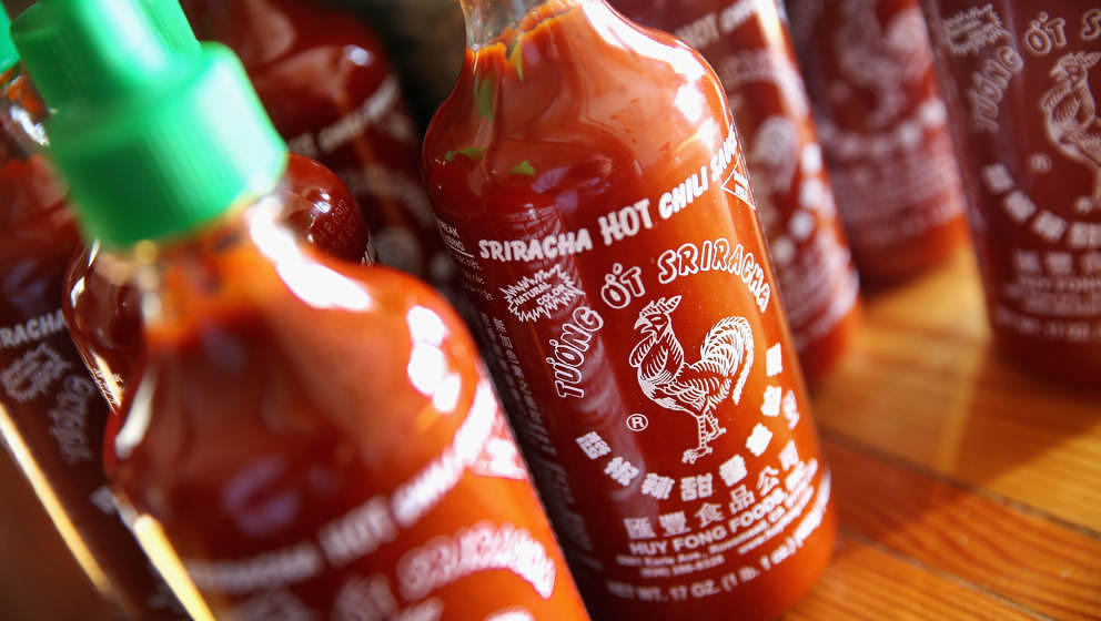CHICAGO, IL - DECEMBER 12:  Bottles of Sriracha hot chili sauce are shown on December 12, 2013 in Chicago, Illinois. Huy Fong