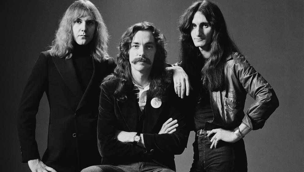 Rush (from left: guitarist Alex Lifeson, drummer Neil Peart and bassist and singer Geddy Lee), Canadian rock band, pose for a