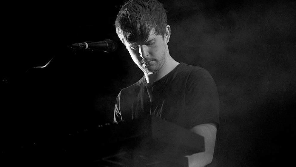 SANTA ANA, CA - OCTOBER 22:  (EDITORS NOTE: Image has been converted to black and white) Singer James Blake performs onstage