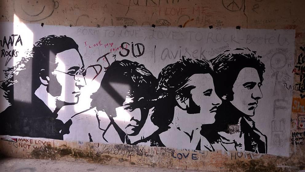 This photograph taken on December 8, 2015 shows graffiti painted on the walls of a hall at the Beatles ashram, as the former