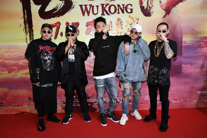 This photo taken on July 9, 2017 shows Chinese rapper PG One (2nd R) posing for a picture during the premiere of the movie 'W
