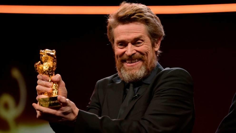 TOPSHOT - US actor Willem Dafoe poses after he received the Honorary Golden Bear award during a ceremony on February 20, 2018